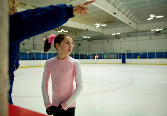 Maureen Garrahan coached Amanda Gollaher last week at North Star Youth Forum ice skating center in Westborough. Gollaher trained with the New England Figure Skating Club before it unraveled last year.