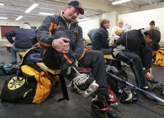 Tom Ryan is back in familiar territory as head hockey coach at his alma mater, Newton North High, after practice at Reilly Memorial Rink in Brighton.