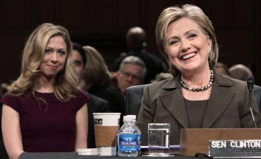 Hillary Clinton, with daughter Chelsea Clinton behind her, gave five hours of testimony during her confirmation hearing yesterday.