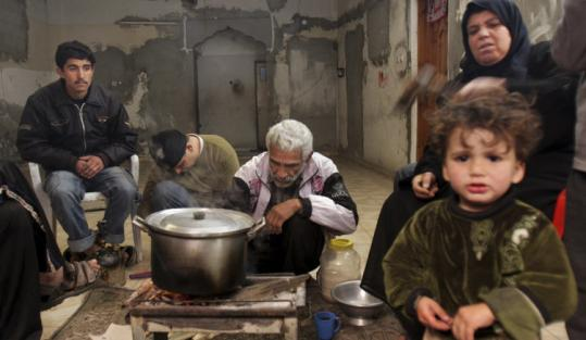 The al-Dali family cooked food for 21 in a Shati refugee camp in Gaza City on Monday. The family has to take turns sleeping.