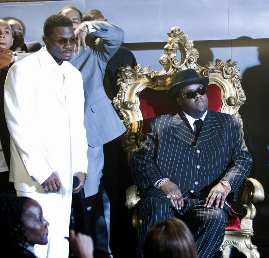 Derek Luke (left) portrays ''Puffy'' Combs, who helped Biggie Smalls (Jamal Woolard, seated) achieve stardom.