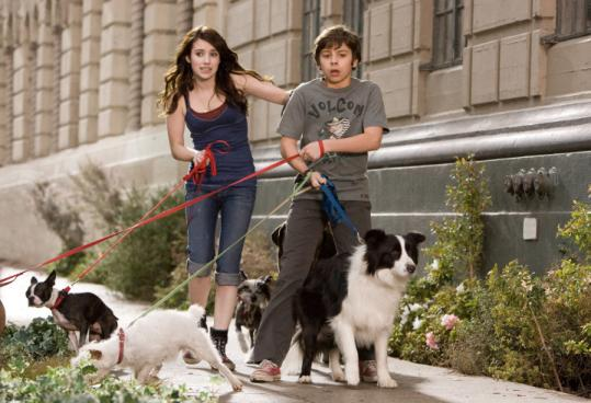 Emma Roberts (left) and Jake T. Austin star in ''Hotel for Dogs,'' based on a children's book from 1971.