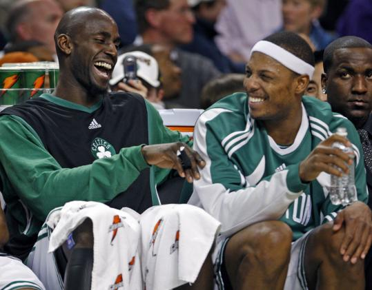 A 32-point victory will do wonders for one's sense of humor, so Kevin Garnett (left) and Paul Pierce yukked it up in the fourth.