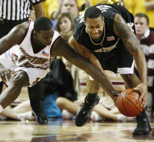 BC's Rakim Sanders (left) can't hold onto the ball as Wake Forest's James Johnson swoops in to get it in the first half.