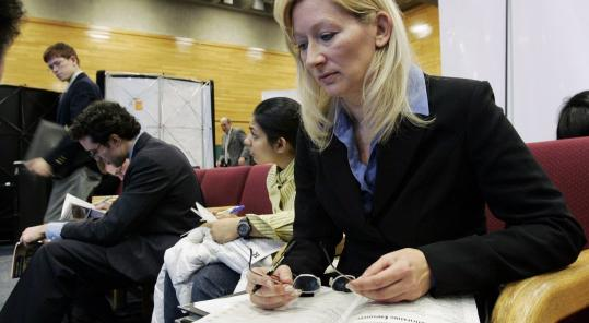 Janet Wos, 43, of Sayerville, N.J., checks through listings during a job fair at Rutgers University last week.