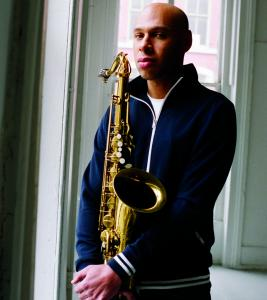 In his Double Trio, Joshua Redman and his saxophone are flanked on each side by bass and drums.
