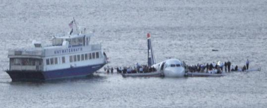 Passengers stood on the wings of the US Airways plane as a ferry pulled up on the Hudson River in New York. Many feared the plane would sink immediately.
