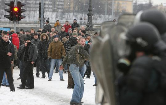 Protesters threw snowballs at police at the beginning of clashes in front of Lithuania's Parliament in Vilnius yesterday.