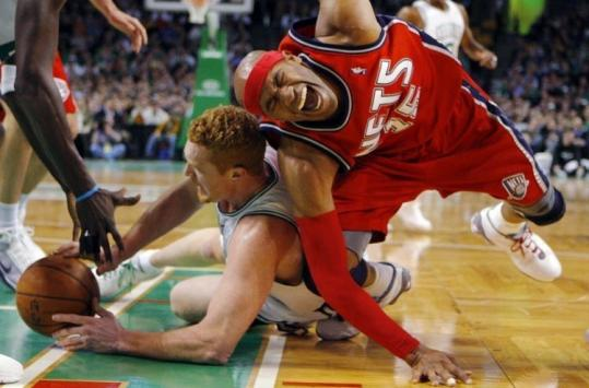 Brian Scalabrine got the loose ball - and Vince Carter got a sore ankle - as the Celtics trounced New Jersey Wednesday.