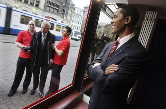 A wax figure of President-elect Barack Obama is on display at Madame Tussauds in Amsterdam. Meanwhile, a figure of his predecessor was carried out of the wax museum.