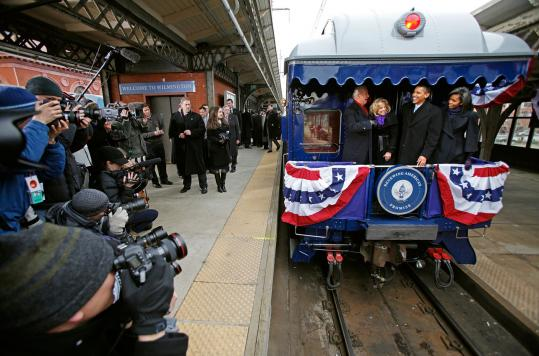 President-elect Barack Obama and his wife, Michelle, with Vice President-elect Joe Biden and his wife, Jill, posed for the media yesterday aboard a train car in Wilmington, Del., during a whistle-stop tour.