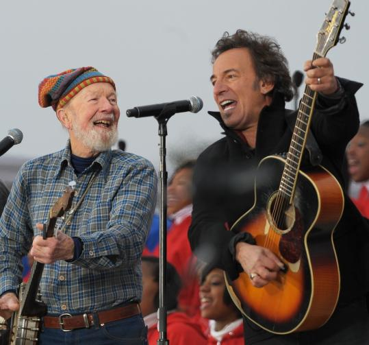 Pete Seeger and Bruce Springsteen at the inaugural concert in Washington, D.C., yesterday.