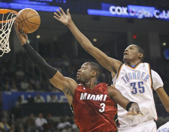 The Thunder's Kevin Durant failed to slow Dwyane Wade, who finished with 32 points and 10 assists in the Heat's win.