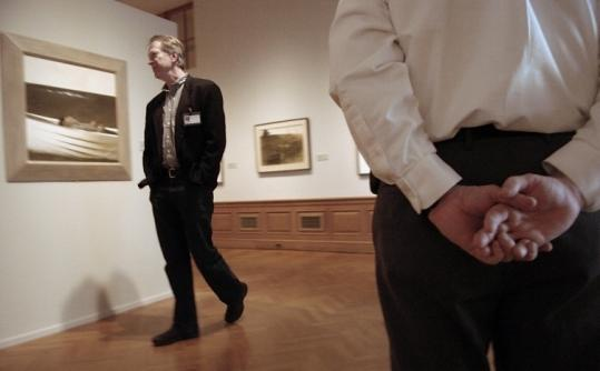 Michael K. Komanecky (left), interim director and chief curator for the Farnsworth Art Museum viewed an Andrew Wyeth painting. About 70 paintings from the Wyeth family are in the museum.