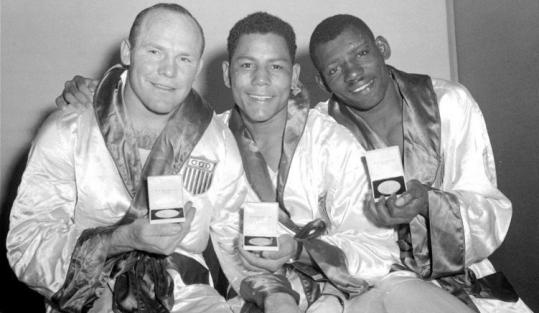 Jose Torres is flanked by fellow American medalists at the Summer Olympics in Melbourne: Peter Rademacher (left), winner of the gold medal in heavyweight, and James Boyd, bronze medal winner in light heavyweight.
