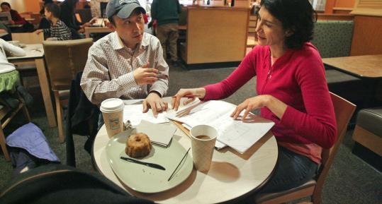 Architects Derrick Choi and Miriam Spear collaborate at Panera Bread in Brookline. Below: Lawyer Rebecca Pontikes on her laptop at Peet's in Harvard Square.