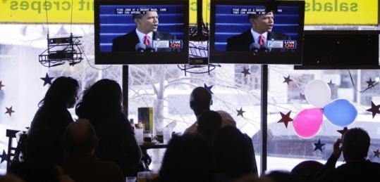 Patrons in a Chicago restaurant were among the millions who watched the inauguration yesterday on television and online.