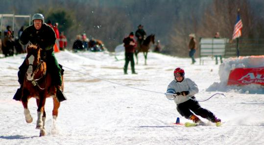 Geoff Smith (right), president of the North American Ski Joring Association, competes at the Newport Winter Carnival in 2006.