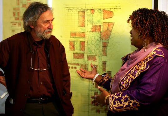 Jan Wampler (left), an MIT professor of architecture, and lead organizer Gerthy Lahens explain details of their Haiti project.