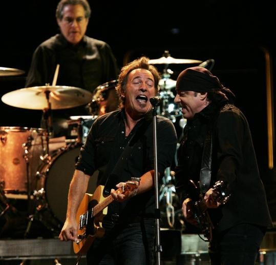 Bruce Springsteen, with E-Streeters Steve Van Zandt (right) a
