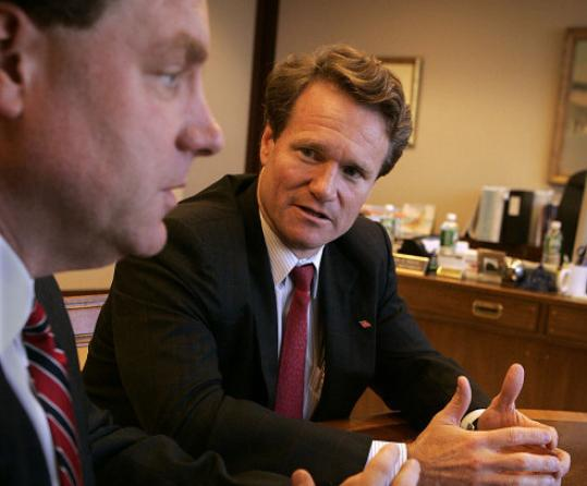 Brian Moynihan (right) is taking a new leadership post at Bank of America.