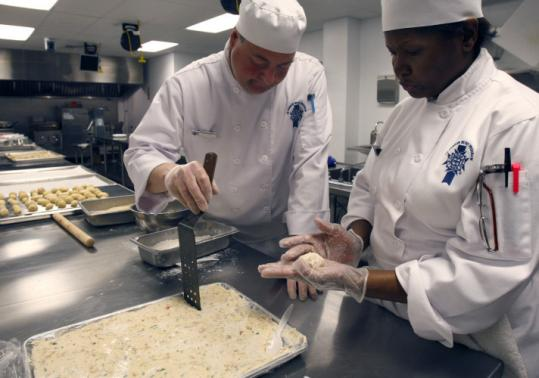 Le Cordon Bleu College students Jeff Dudley (left) and Ilene Reyes have no regrets about switching career paths.