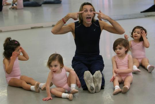 Photos by David L. Ryan/Globe StaffLuciano Aimar instructed his students during a class for 2- and 3-year-olds at the ballet school's Boston location this week.