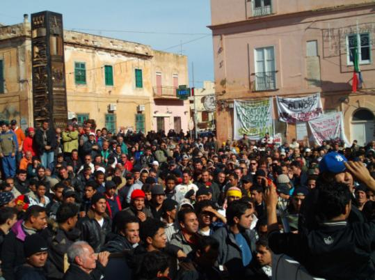 Some of the migrants who broke out of an immigration facility on a Sicilian island took part in a demonstration.