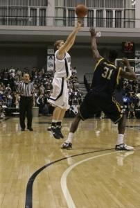 Xavier's Brad Redford fires from behind the new 3-point distance, 20 feet 9 inches.