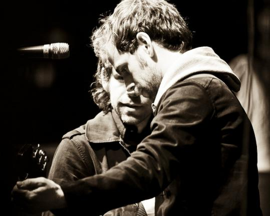 Bryce Dessner (foreground, with his brother Aaron) ranges from rock to classical to art.