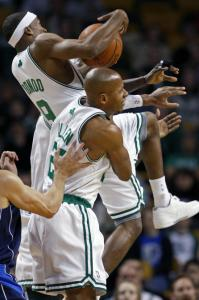 Ray Allen and Kevin Garnett (hidden) ''picked up their teammate'' when Rajon Rondo went for a ride during a battle for a loose ball.