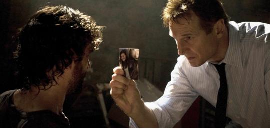 Liam Neeson (right) interrogates a man he suspects of kidnapping his daughter.