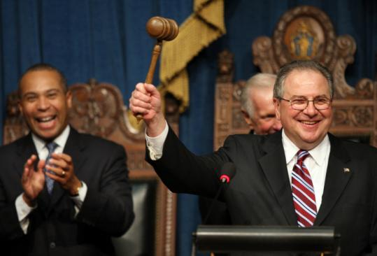 Robert A. DeLeo raised the speaker's gavel yesterday after being elected to lead the Massachusetts House. Governor Deval Patrick (left) attended the ceremony.