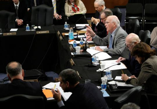 The Senate Judiciary Committee headed by Senator Patrick Leahy (center, at table) yesterday approved Eric Holder to be attorney general. President Obama's nomination then moved to the full Senate.