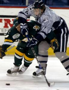 When push came to shove in this Hockey East clash, Danny Dries (right) and New Hampshire were able to fend off Dean Strong and Vermont.