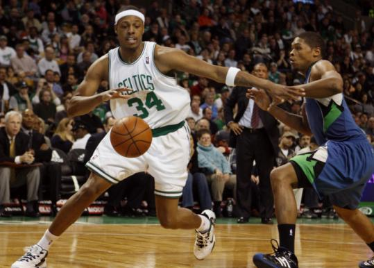 Minnesota's Ryan Gomes (right) is forced to watch former Celtics teammate Paul Pierce drive in the fourth quarter.