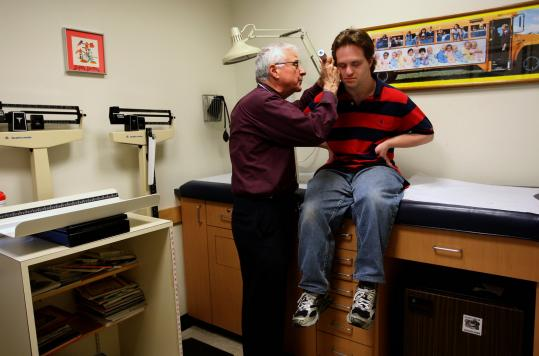 Dr. Dan Palant, a pediatrician in Lexington, still treats longtime patient Shalom Lowell, who is 26 and has Down syndrome.