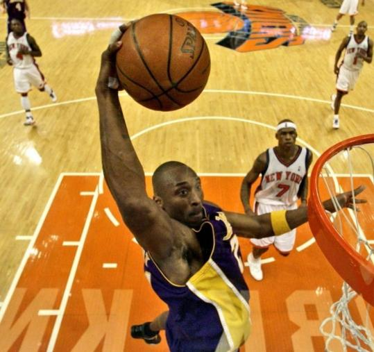 Kobe Bryant, who has his way with the Knicks all night, prepares to dunk for 2 of his 61 points as Al Harrington can only watch.