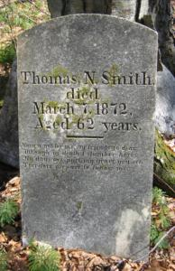 The headstone of Native American Thomas Smith - and that of his brother - were found leaning on a tree.