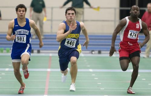 Andover junior Christopher McConnell (44) beats Josh Adams (981) and Demar Barnaby (474) to win the 55-meter dash.