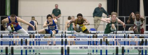 BC High's Corey Thomas (center) gets off to an early lead and wins the 55-meter hurdles.