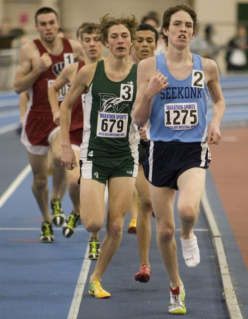 Despite loosing his left sneaker mid-race Johnny Gregorek (1275) holds off the pack in the mile.