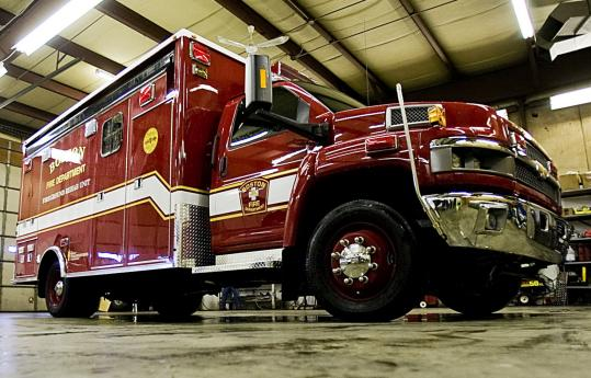 A ''fireground rehabilitation unit'' designed to provide relief services to firefighters sat in the garage at Specialty Vehicles Inc. in North Attleborough yesterday. The company is awaiting a $205,000 payment from the foundation headed by actor Denis Leary.