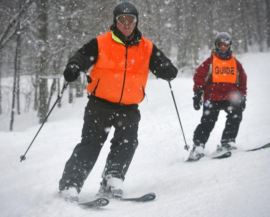 Brian Russell, legally blind from retinitis pigmatosis, glided downhill ahead of guide Kathy Kay at Loon Mountain.