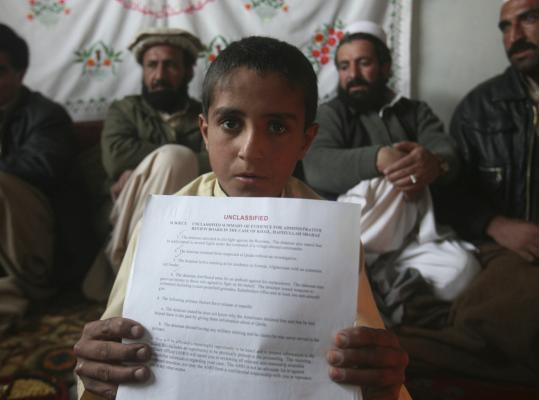 Attiqullah, 10, son of Hafizullah Shahbaz Khiel, showed documents proclaiming Hafizullah's innocence at his uncle's house on the outskirts of Kabul, Afghanistan, in January.