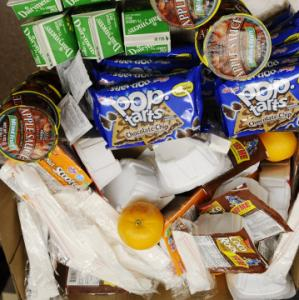 DAVID RICHARD/ASSOCIATED PRESSFruits, cereal, and applesauce are among the items given to students at Lorain Southview High School.