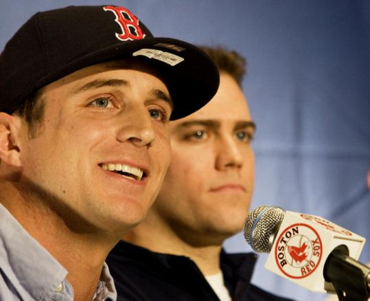 Theo Epstein was confident enough in Rocco Baldelli (left) that he gave him a deal that could reach $7.5 million this season.