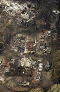 Several homes and vehicles in the Kinglake district, about 50 miles north of Melbourne, were left leveled yesterday by the wildfires. At least 18 of the deaths were from the area.