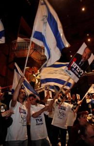 Supporters of Avigdor Lieberman rallied during a campaign event yesterday in Haifa. Lieberman's party, Yisrael Beitenu, has scored the biggest gains in the campaign's final week.