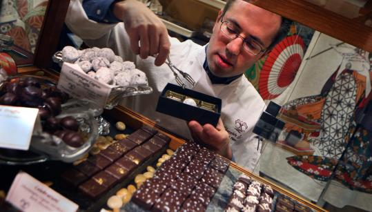 Above: Chocolatier Joshua Needleman fills a box with bonbons. Below: Chocolate mendiant at Chocolate Springs Café.